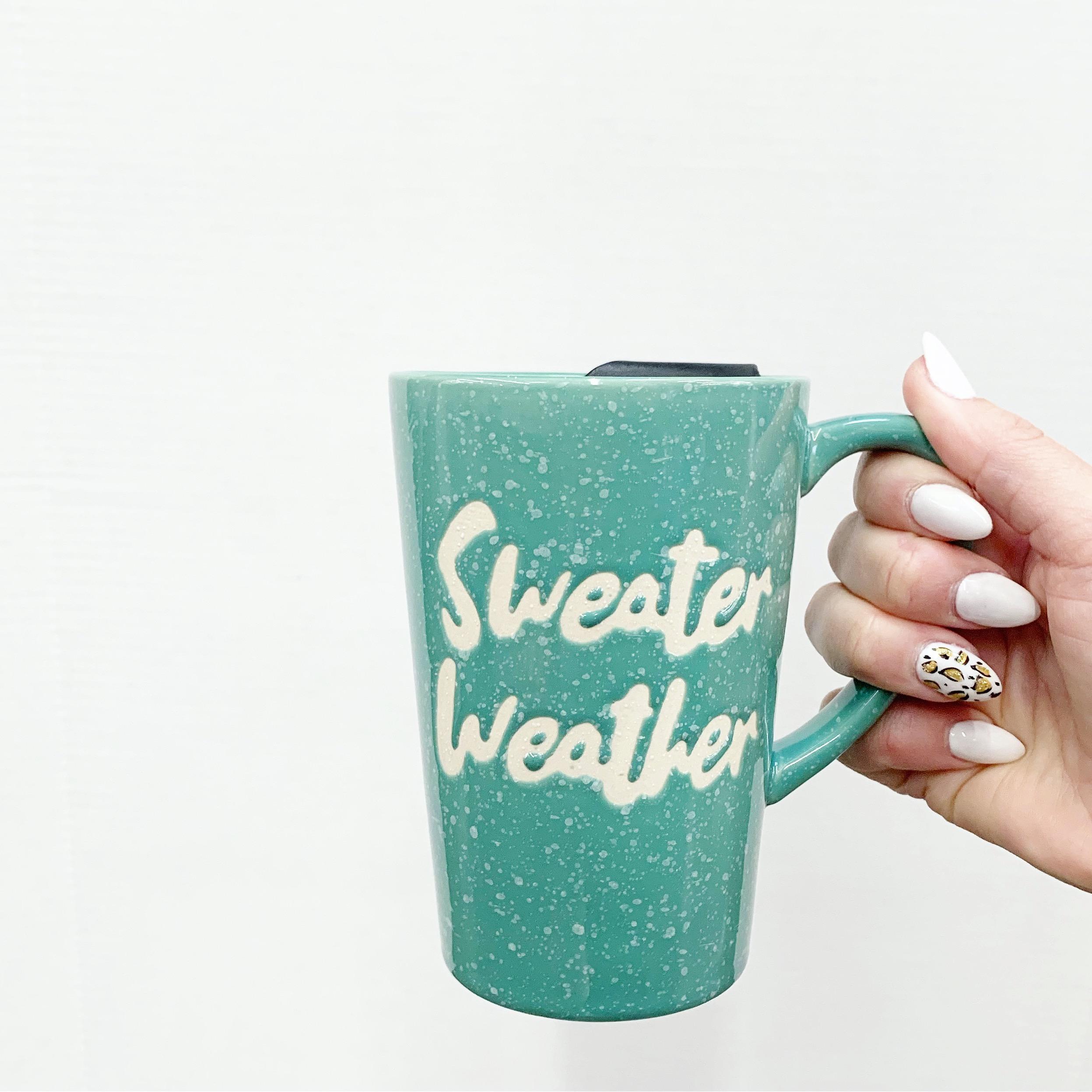 green coffee mug that says sweater weather
