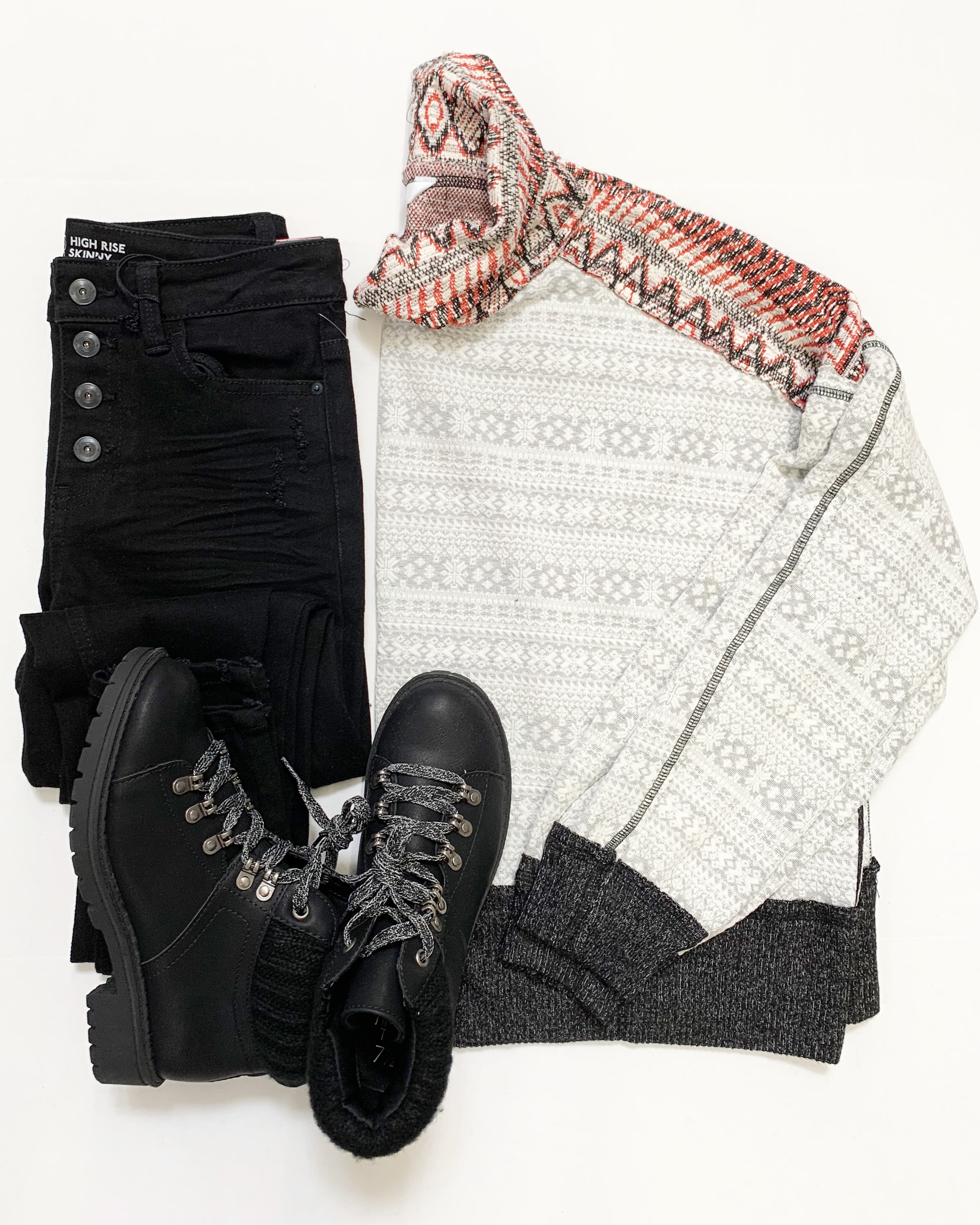 cowl neck snowflake print top with black jeans and hiker boots
