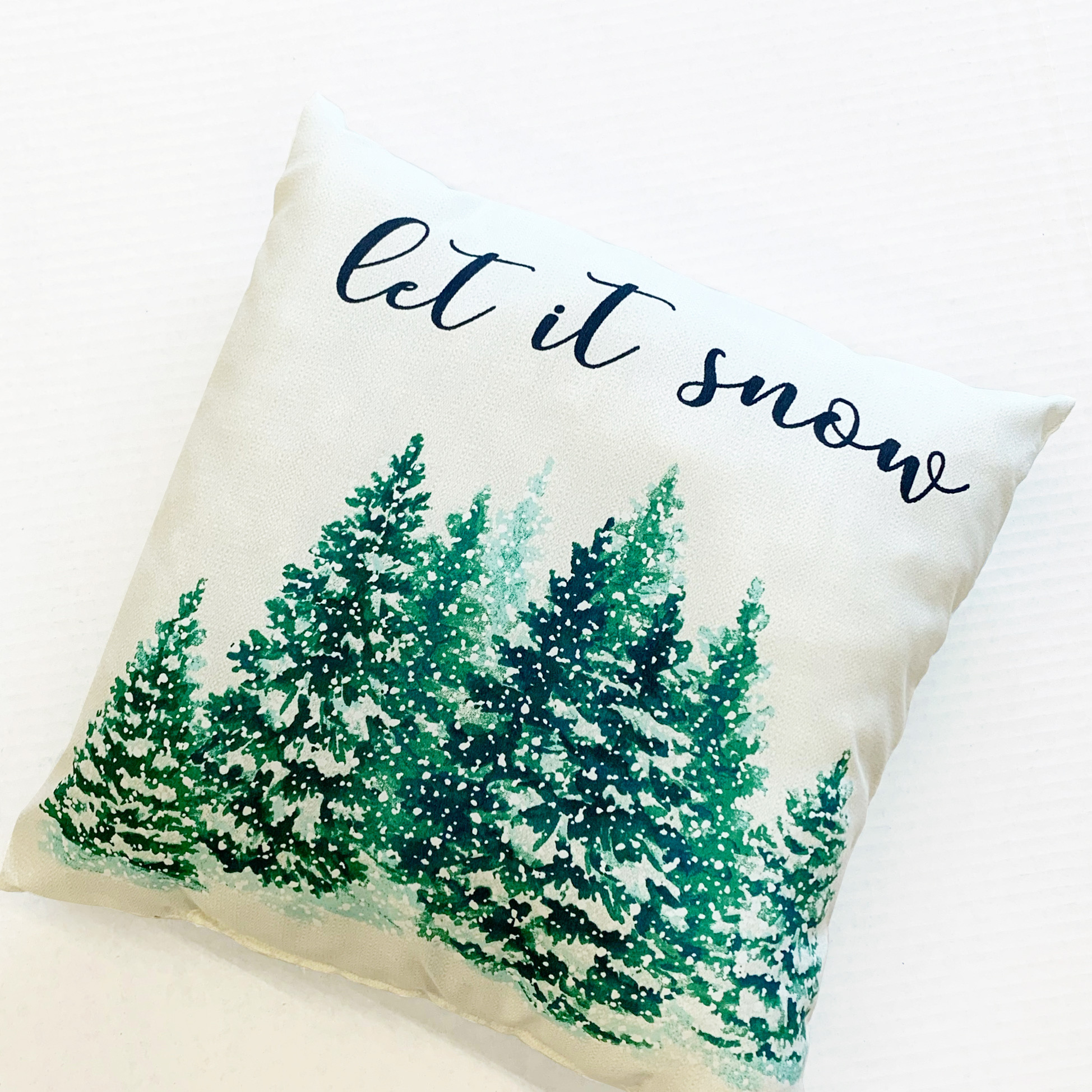 "white ""let it snow"" pillow with pines"