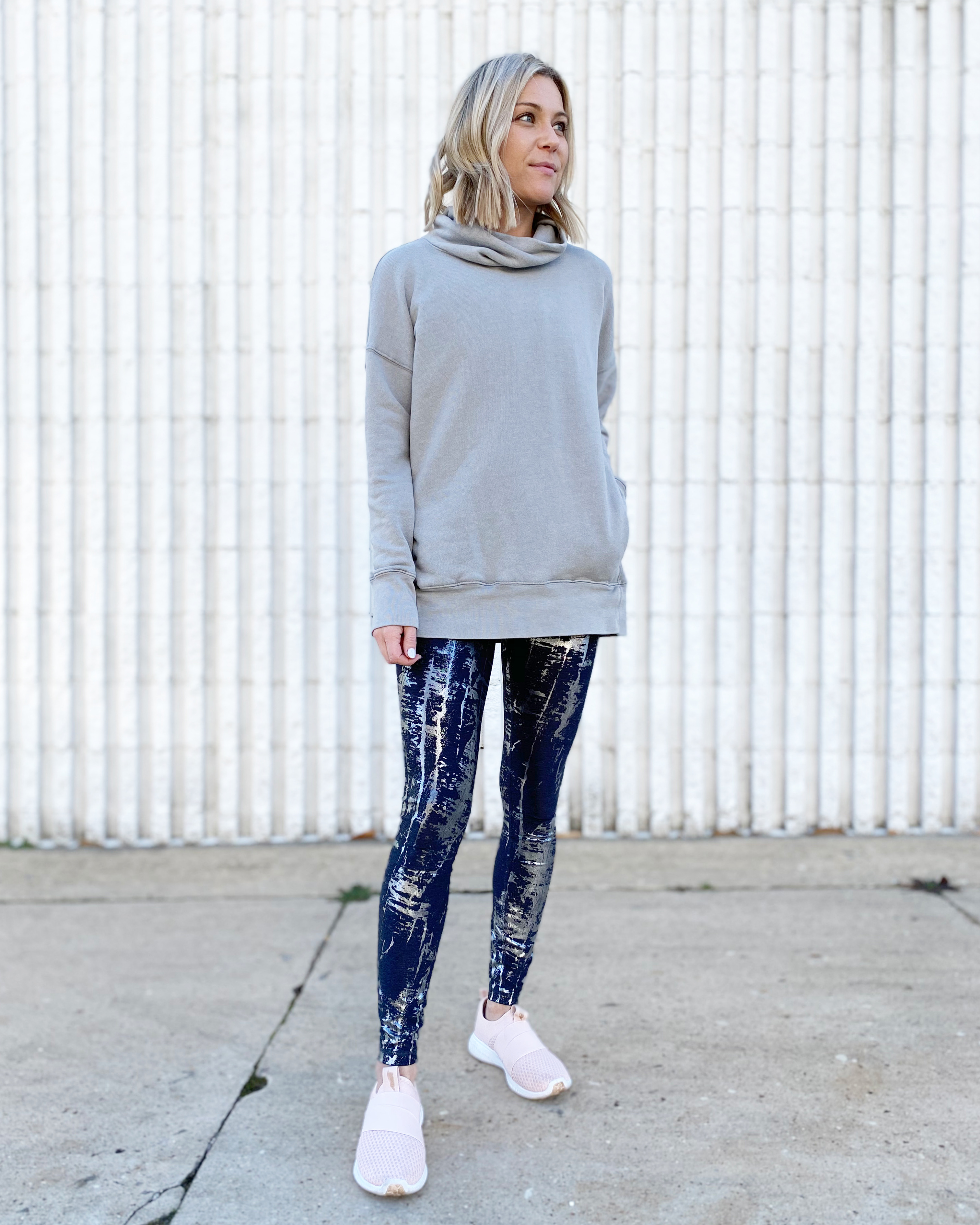 woman wearing avia foil leggings and cowl neck tunic