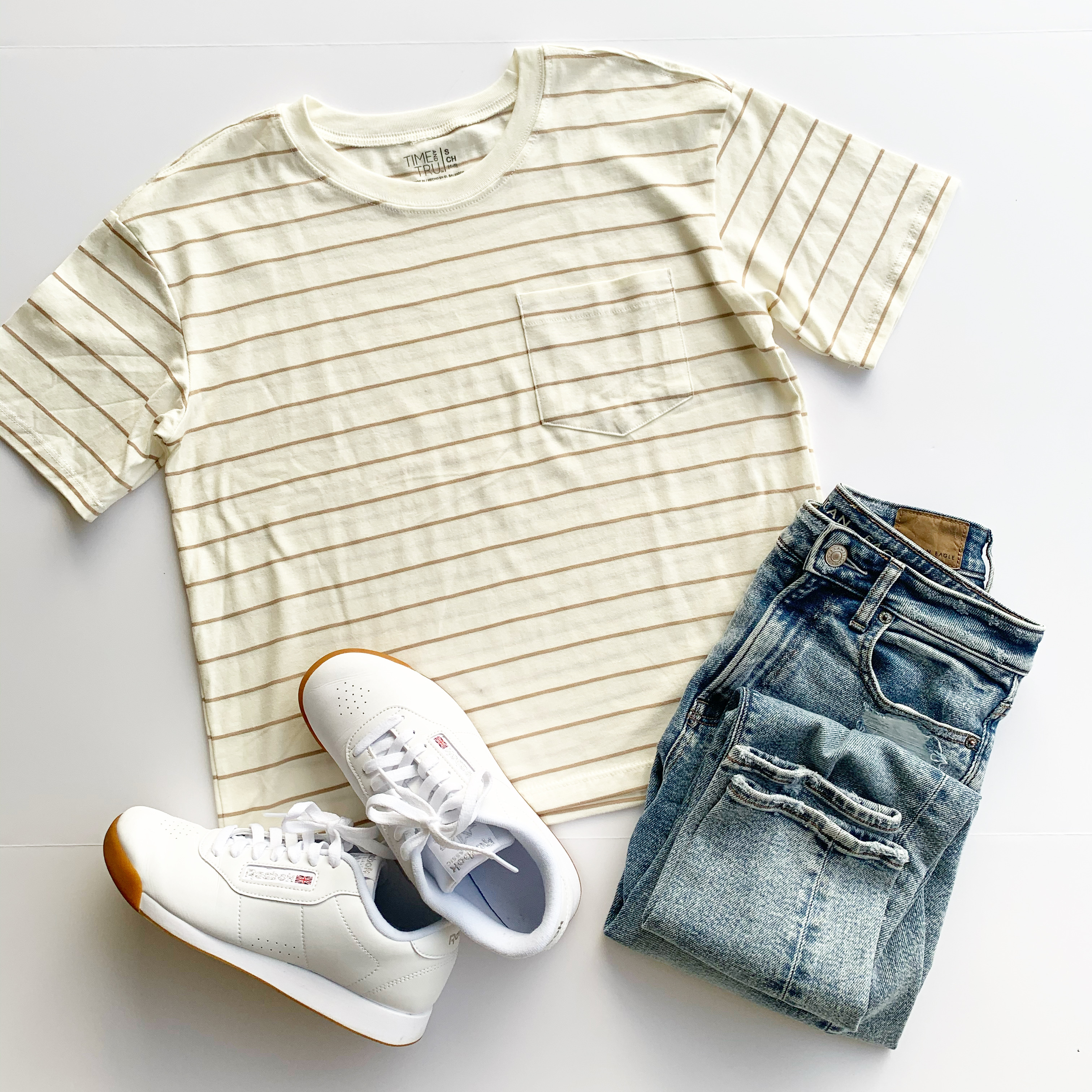 flat lay outfit photo with striped boyfriend tee with mom jeans and white reebok classic sneakers