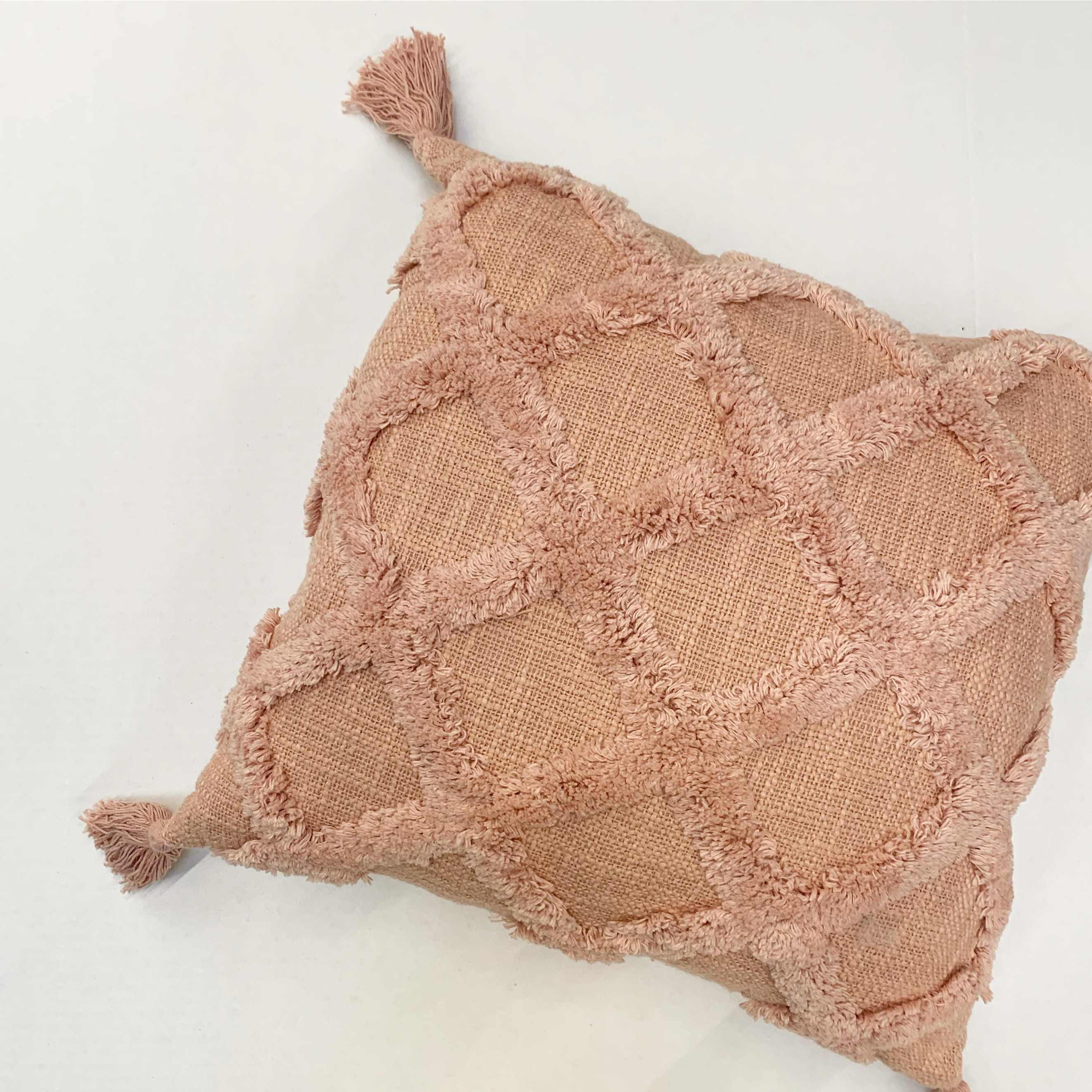 coral trellis pillow with fringe